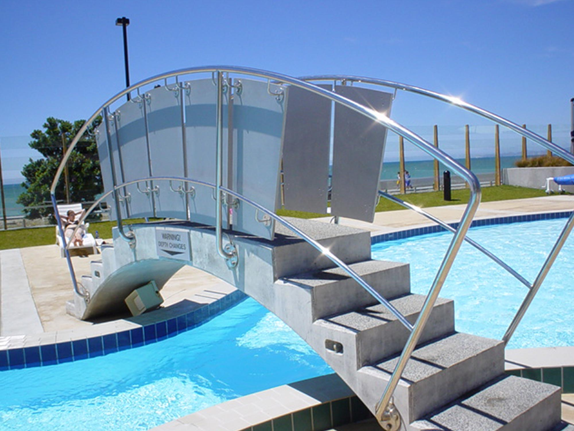 curved hand railing at ocean spa pools
